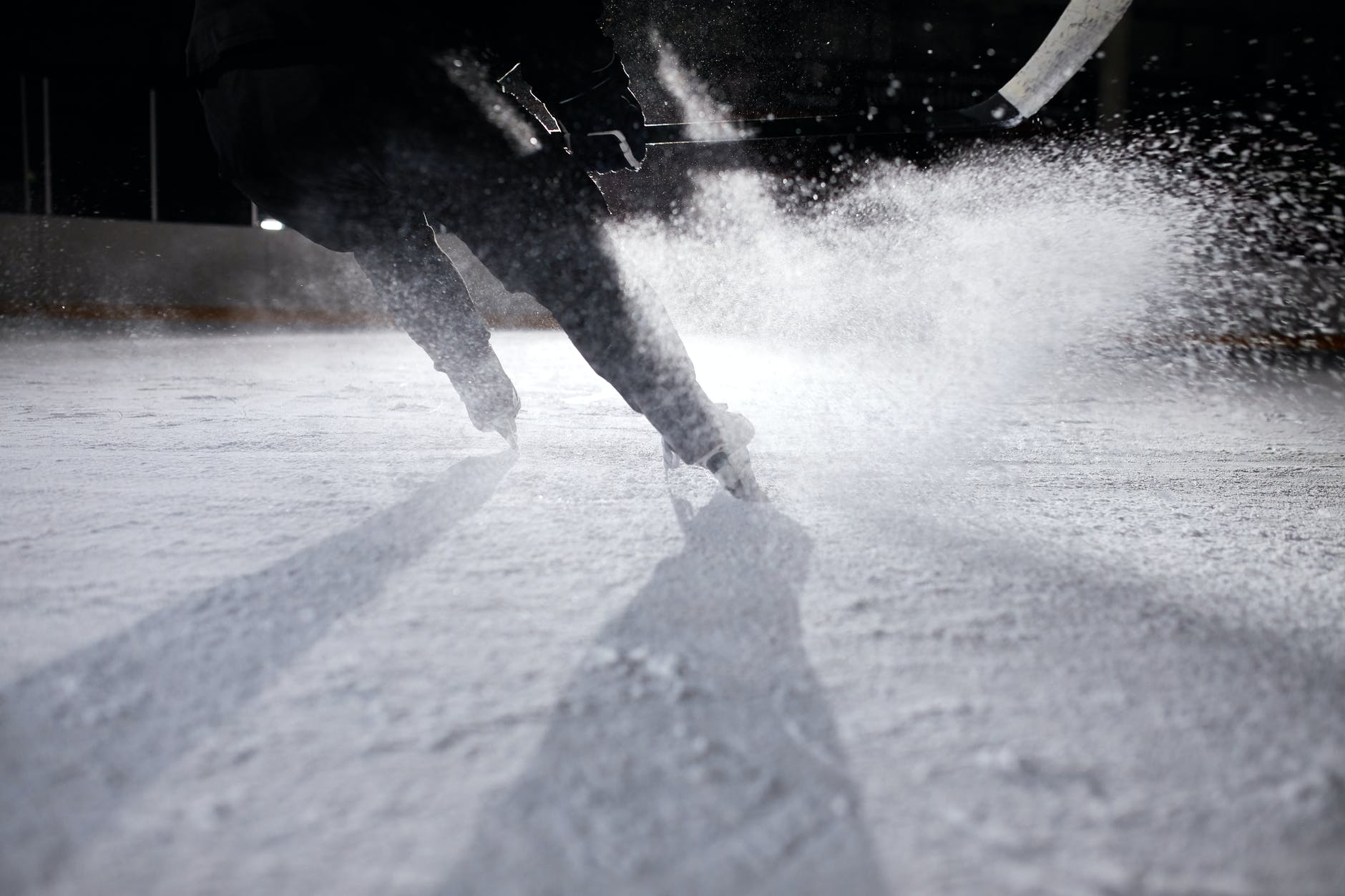 person in black pants walking on snow covered ground
